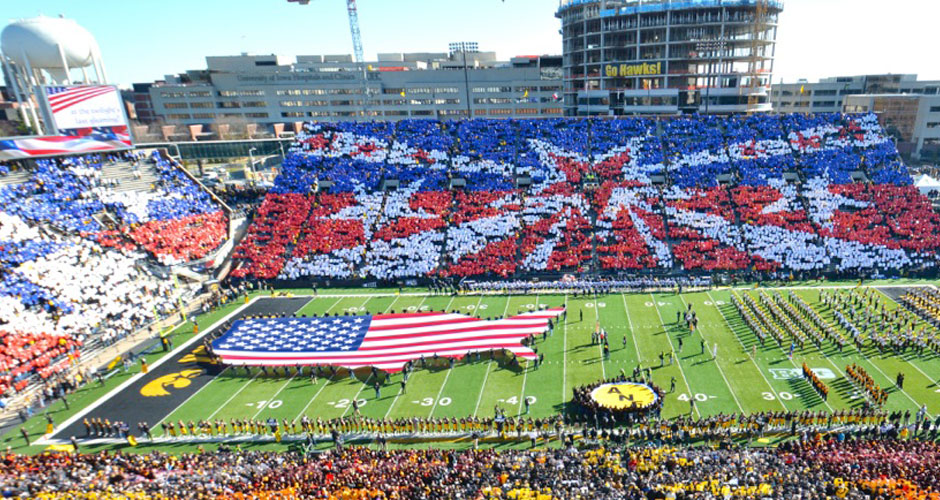 Image of a football stadium doing a card stunt.
